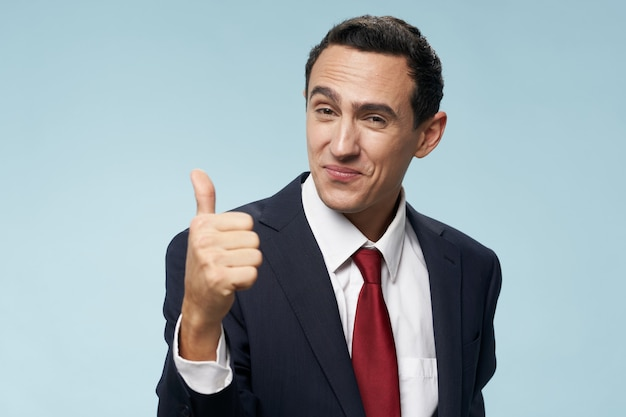 Man in classic suit positive hand gesture