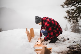 Man cleaning board from snow