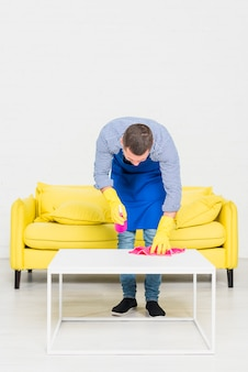 Man cleaning his home