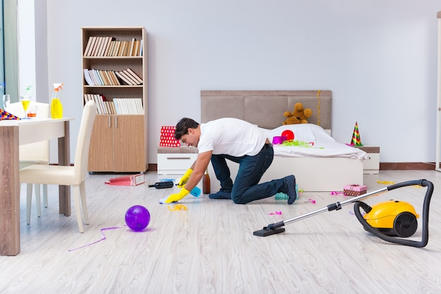 Man cleaning the house after christmas party