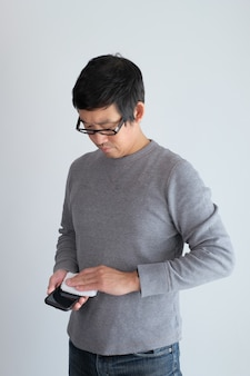 Man cleaning the phone surface