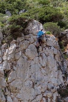 Man climbs a cliff