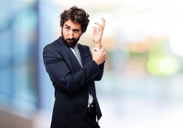 Man clutching a hand