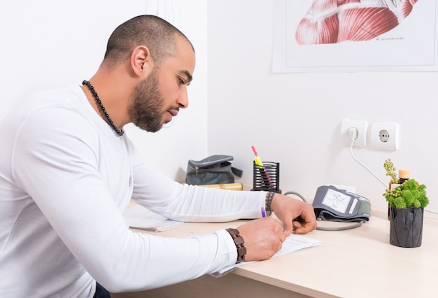 Man completing a questionnaire or report