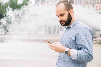 Man concentrated on phone