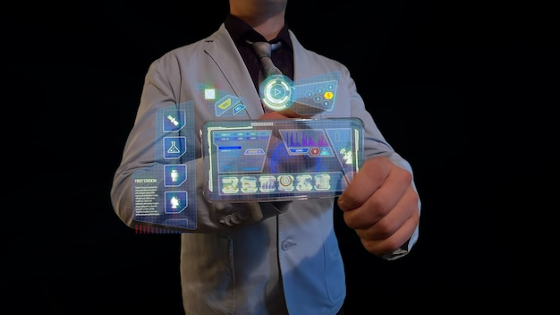 Man controls futuristic screen of the future with interface on transparent display