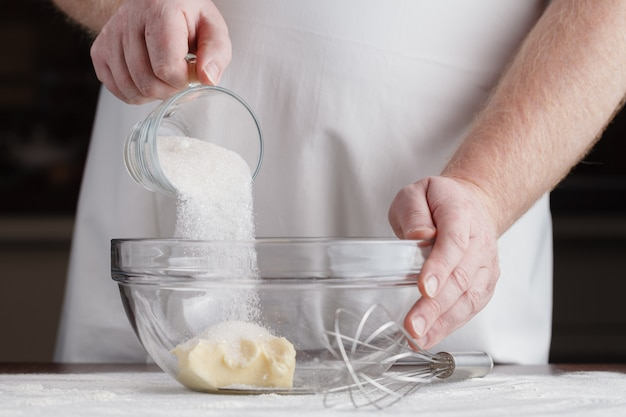 Man the cook is occupied with dough preparation