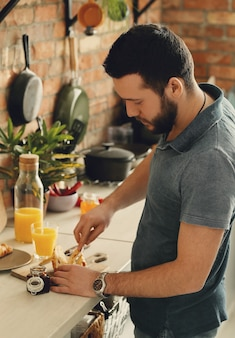 Man cooking in the kitchen. breakfast morning