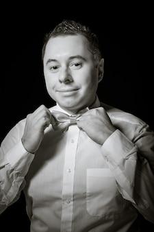 Man corrects a necktie