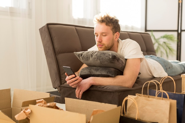 Man on couch holding smartphone