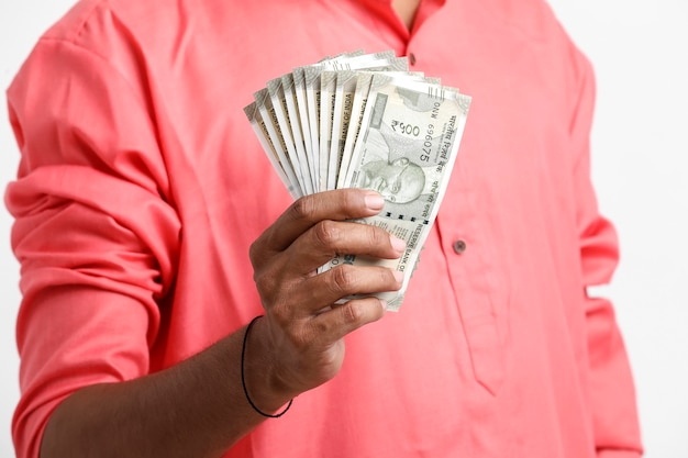 Man counting newly launched indian five hundred rupees