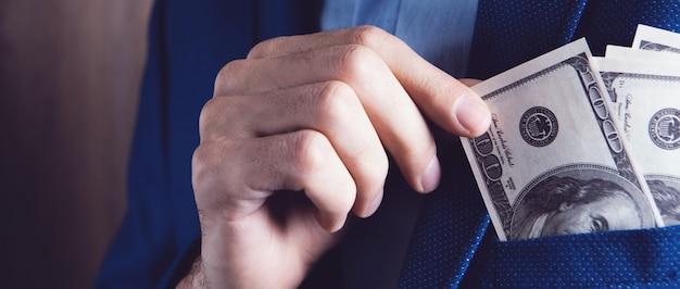 Man counts money calculating finance