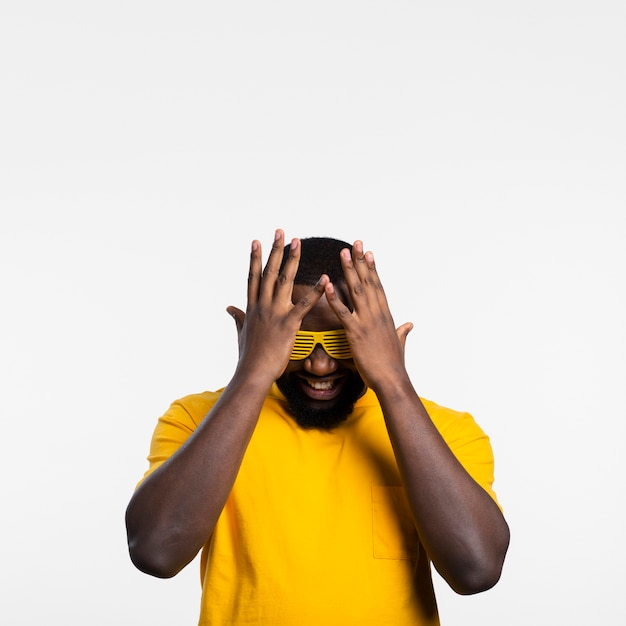 Man covering face with hands