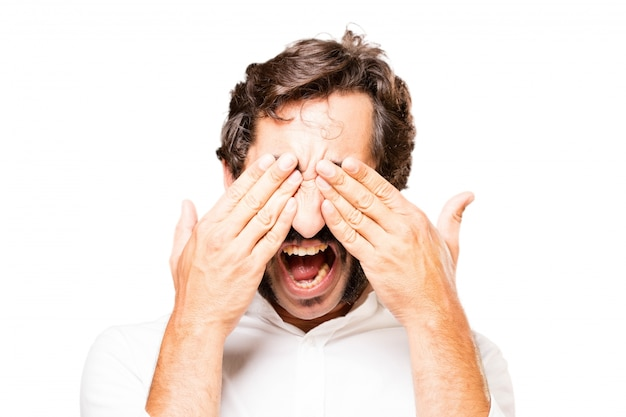 Man covering his eyes with hands