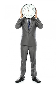 Man covering his face with clock