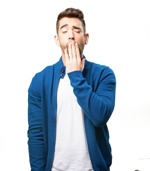 Man covering his mouth while yawning