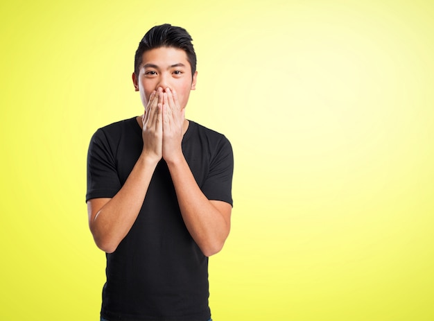 Man covering his mouth with his hands