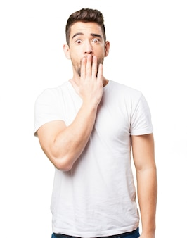 Man covering his mouth with one hand