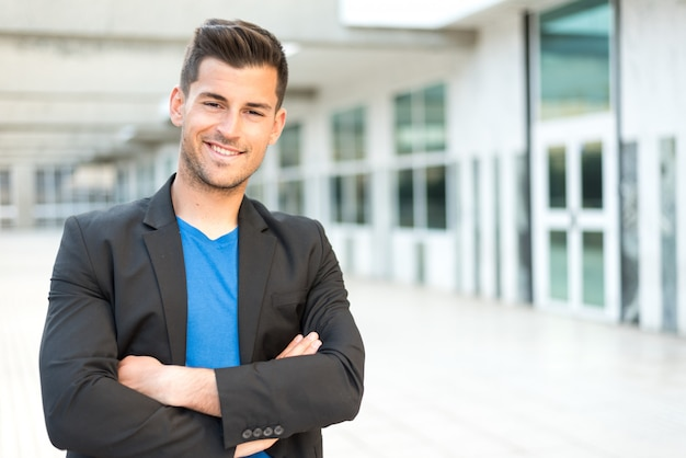 Man crossed arms smiling businessman