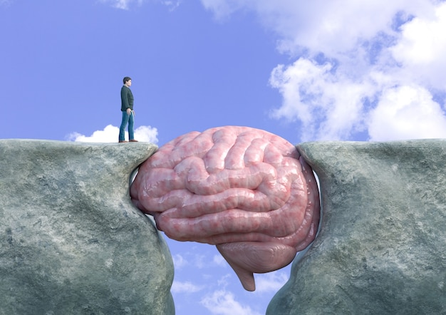 Man crossing cliff with brain