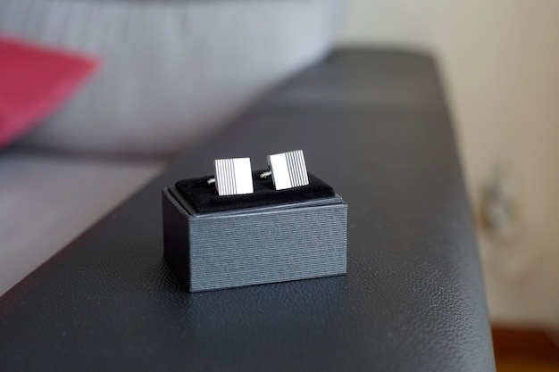 Man cufflinks on its box