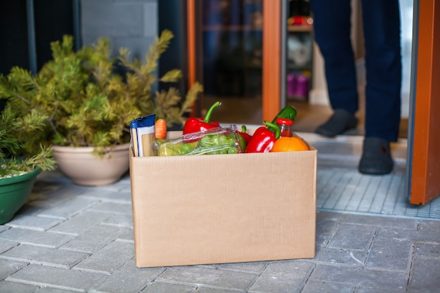 Man customer accepting box with food. delivery