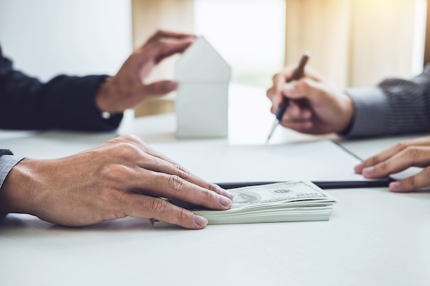 Man customer signing buying home policy document agreement, successful loan contract