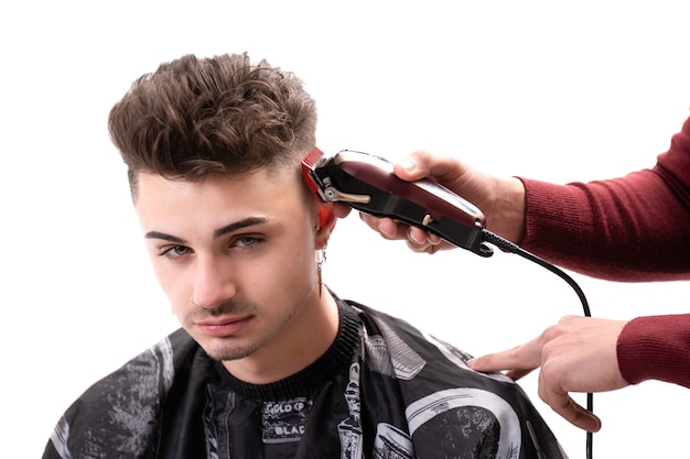 Man cutting hair with razor to a client on white background