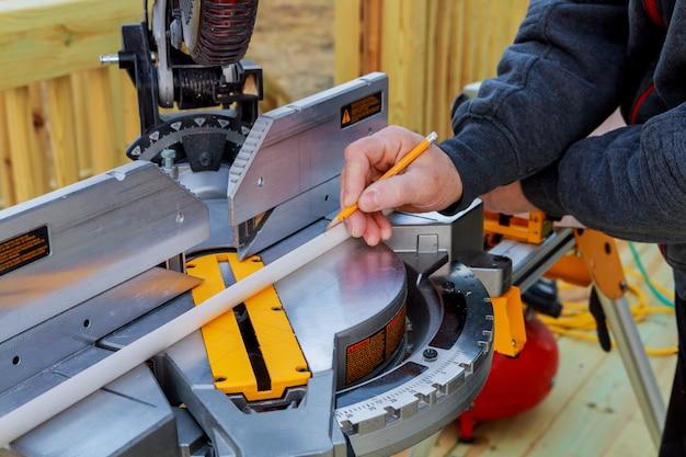 Man cutting wood on electric saw