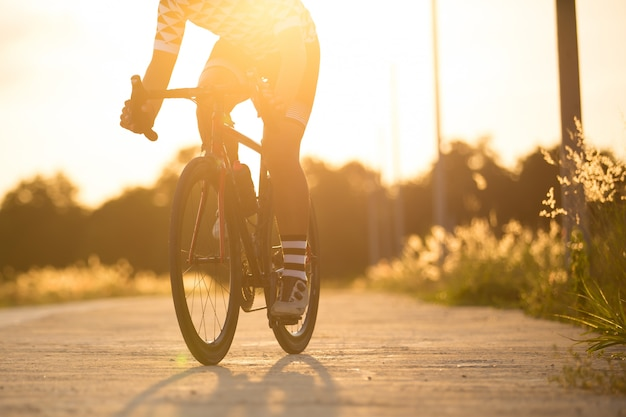 Man in cycling clothes riding a bike