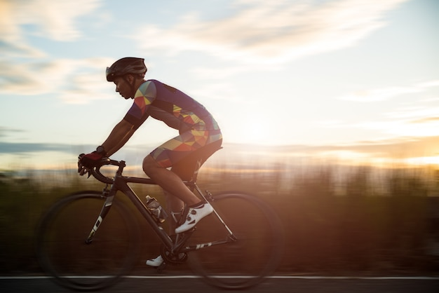 Man cycling road bike in the morning, sport concept