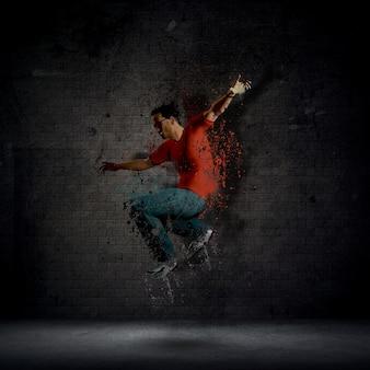 Man dancing against a dark brick wall
