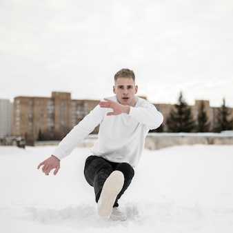 Man dancing to hip hop in the snow
