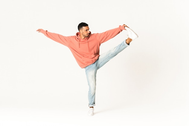 Man dancing street dance style over isolated white wall