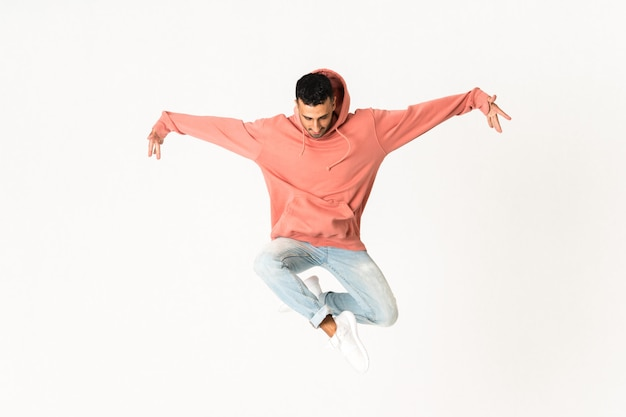 Man dancing street dance style over isolated white