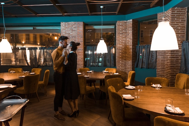 Man dancing with woman in restaurant