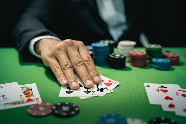 Man dealer or croupier shuffles poker cards in a casino