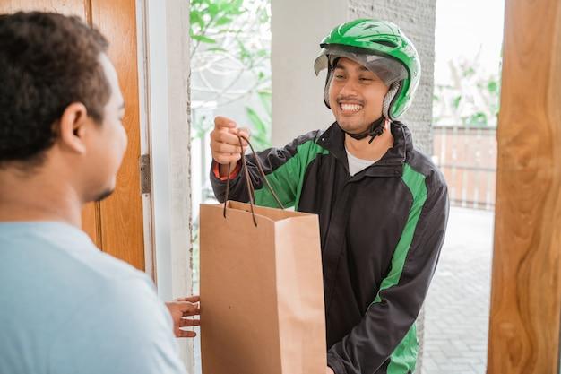 Man delivery service uber send shopping bag