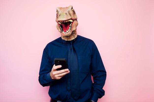 Man in dinosaur mask using smartphone