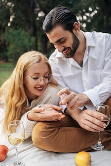 Man disinfecting his girlfriend's hands