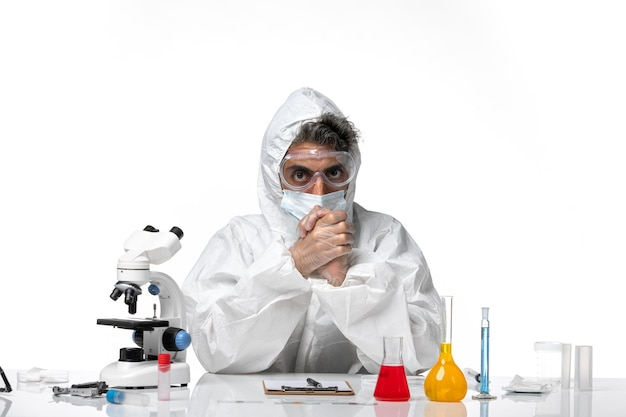 Man doctor in protective suit with sterile mask on white
