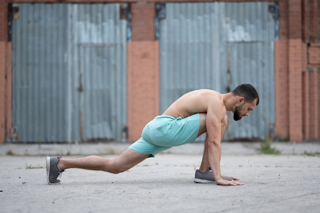 A man does a warm-up before training on the street. workout, training, lifestyle