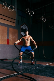 Man doing crossfit with rope
