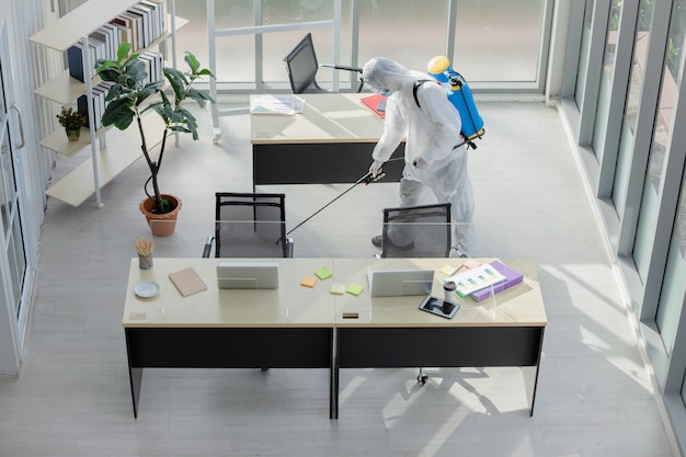 Man doing disinfection at office