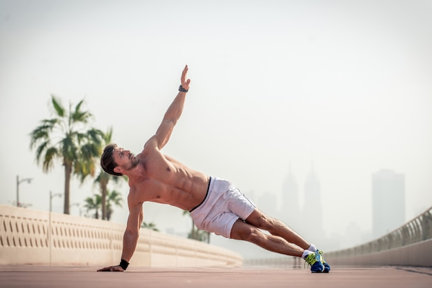 Man doing exercise in the street