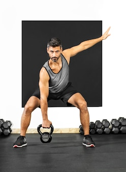 Man doing exercises with a kettlebell weight