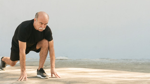 Man doing lunges copy space