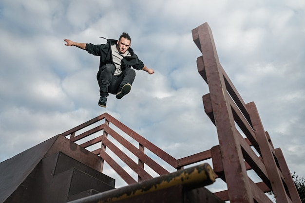 Man doing parkour in city. athlete practicing free running.