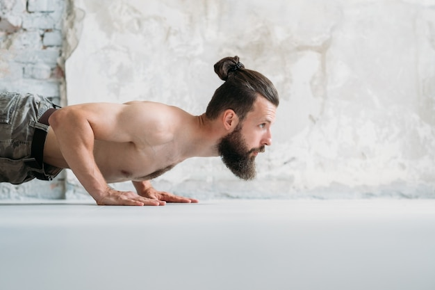 Man doing push ups. fitness and bodybuilding. sport and physical activity.