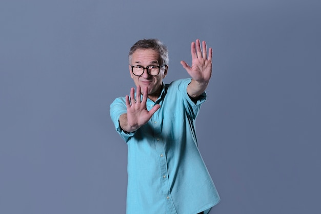 Man doing stay away gesture